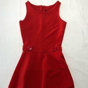 Red knee length red dress.